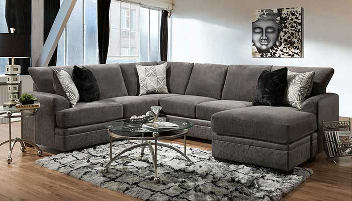 6 seater grey sectional with black and white rug and metal framed coffee table and glass top