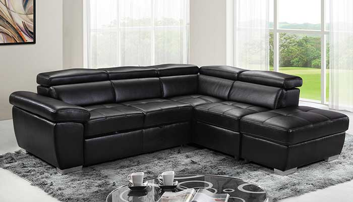 black faux leather sectional on grey rug