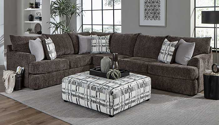 Chenille Grey Sectional with black and white ottomon