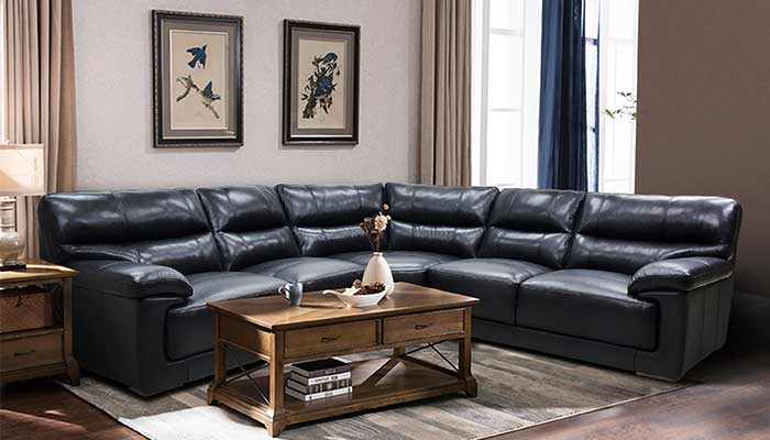 black leather sectional with brown coffee table